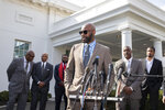 Former NFL football player Jerry Rice speaks after walking out of the West Wing of White House, Tuesday, Feb. 18, 2020, in Washington. It was announced that President Donald Trump has granted a full pardon to Edward DeBartolo Jr., former owner of the San Francisco 49ers NFL football team convicted in gambling fraud scandal. (AP Photo/Alex Brandon)