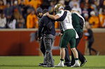 UAB quarterback Tyler Johnston III (17) is helped to the sideline after being injured in the second half of an NCAA college football game against Tennessee, Saturday, Nov. 2, 2019, in Knoxville, Tenn. (AP Photo/Wade Payne)