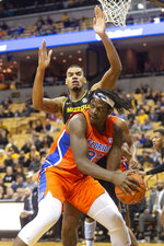 Florida's Jason Jitoboh, bottom, looks to pass around Missouri's Axel Okongo, top, during the first half of an NCAA college basketball game Saturday, Jan. 11, 2020, in Columbia, Mo. (AP Photo/L.G. Patterson)