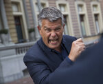 Self-styled Dutch positivity guru Emile Ratelband answers questions during an interview in Amsterdam, Netherlands, Monday, Dec. 3, 2018. A Dutch court has rejected the request of a self-styled positivity guru to shave 20 years off his age, in a case that drew worldwide attention. Emile Ratelband last month asked the court in Arnhem to formally change his date of birth to make him 49, instead of his real age of 69. He argued his request was consistent with other personal transformations, such as the ability to change one's name or gender. The Dutch court said age matters under Dutch law. (AP Photo/Peter Dejong)