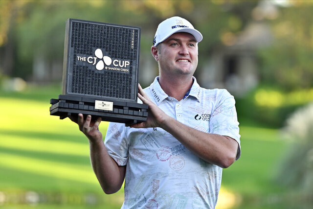 Jason Kokrak holds the championship trophy after winning the CJ Cup golf tournament at Shadow Creek Golf Course Sunday, Oct. 18, 2020, in North Las Vegas. (AP Photo/David Becker)