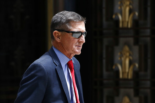 FILE - In this Monday, June 24, 2019, file photo, Michael Flynn, President Donald Trump's former national security adviser, departs a federal courthouse after a hearing, in Washington. Trump said Sunday, March 15, 2020, that he is considering a full pardon for Flynn, who had pleaded guilty to lying to the FBI about dealings with Russia's ambassador before Trump took office. (AP Photo/Patrick Semansky, File)