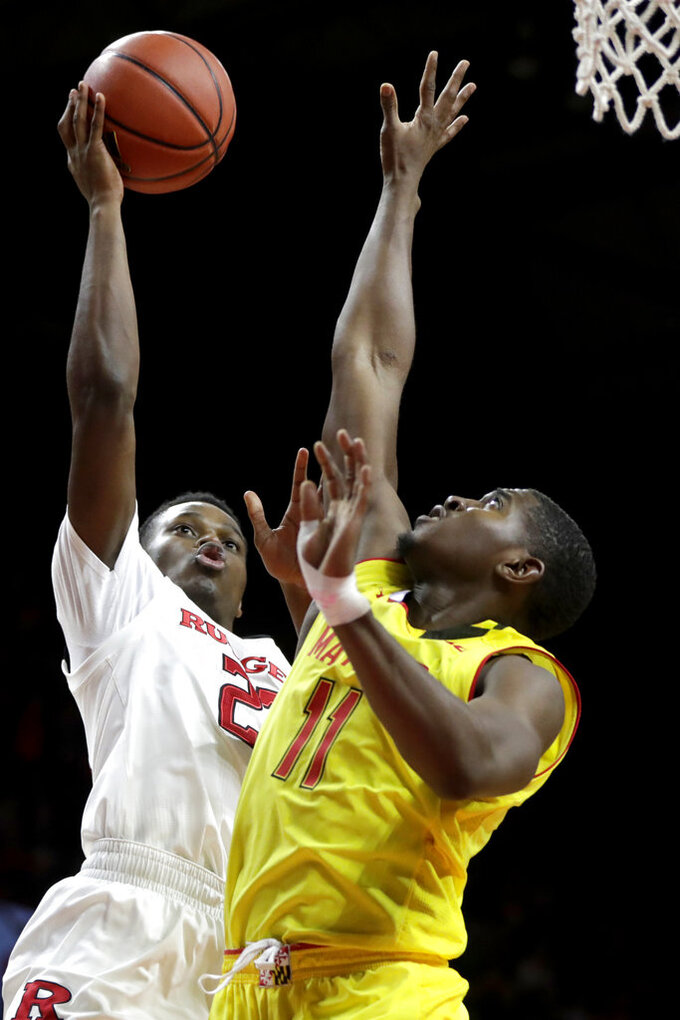 Rutgers guard Montez Mathis, left, goes up for a shot against Maryland guard Darryl Morsell during the second half of an NCAA college basketball game, Saturday, Jan. 5, 2019, in Piscataway, N.J. Maryland won 77-63. (AP Photo/Julio Cortez)