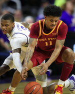 Kansas State guard DaJuan Gordon (3) reaches in on Iowa State guard Prentiss Nixon (11) during the second half of an NCAA college basketball game in Manhattan, Kan., Saturday, March 7, 2020. (AP Photo/Orlin Wagner)