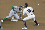 Oakland Athletics' Jurickson Profar slides past New York Yankees' Didi Gregorius (18) for a two-run double during the sixth inning of a baseball game Friday, Aug. 30, 2019, in New York. (AP Photo/Frank Franklin II)