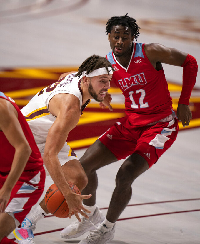 Minnesota guard Gabe Kalscheur (22) loses control of the ball while driving to the rim in the first half of an NCAA college basketball game against Loyola Marymount, Monday, Nov. 30, 2020, in Minneapolis. (Jeff Wheeler/Star Tribune via AP)