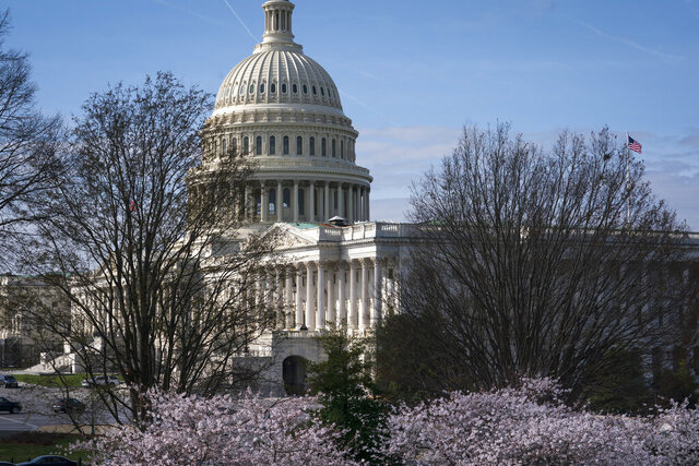 The Capitol is seen as lawmakers negotiate on the emergency coronavirus response legislation, at the Capitol in Washington, Wednesday, March 18, 2020. (AP Photo/J. Scott Applewhite)
