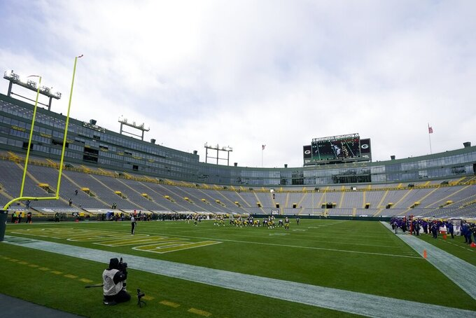 The seats at Lambeau Field are empty during the first half of an NFL football game between the Green Bay Packers and the Minnesota Vikings Sunday, Nov. 1, 2020, in Green Bay, Wis. (AP Photo/Morry Gash)