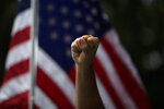 A demonstrator raises his fist during a protest over the death of George Floyd, in Anaheim, Calif., June 1, 2020. (AP Photo/Jae C. Hong)