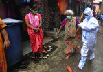 An elderly woman is helped by a health worker before screening her for COVID-19 symptoms in Dharavi, one of Asia's biggest slums, in Mumbai, India, Tuesday, Aug. 11, 2020. India has the third-highest coronavirus caseload in the world after the United States and Brazil. (AP Photo/Rafiq Maqbool)