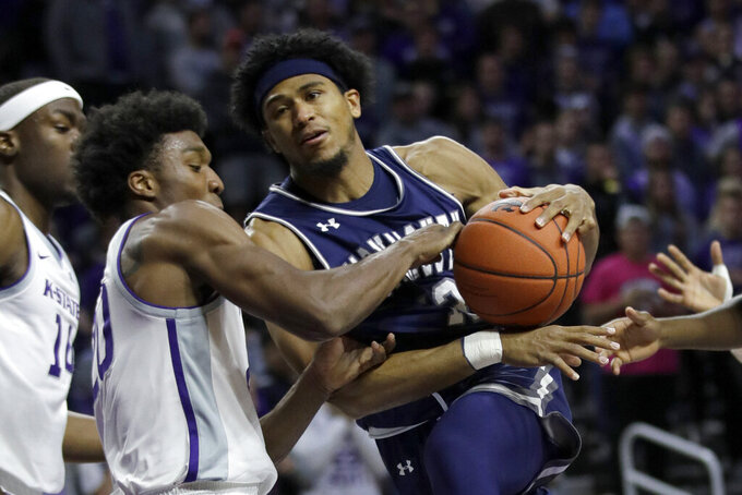 Monmouth guard Marcus McClary, right, drives on Kansas State forward Xavier Sneed during the first half of an NCAA college basketball game in Manhattan, Kan., Wednesday, Nov. 13, 2019. (AP Photo/Orlin Wagner)