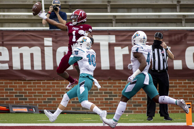 Troy wide receiver Kaylon Geiger (1) misses a pass to the end zone with Coastal Carolina defensive back Alex Spillum (10) defending during an NCAA college football game, Saturday, Dec. 12, 2020, in Troy, Ala. (AP Photo/Vasha Hunt)