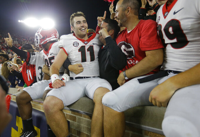 FILE - In this Sept. 9, 2017, file photo, Georgia quarterback Jake Fromm (11) celebrates in the stands following a 20-19 win over Notre Dame in an NCAA college football game in South Bend, Ind. Two years ago, cheered on by a sea of red in the shadow of Touchdown Jesus, Georgia signaled its re-emergence as a national powerhouse with a victory at Notre Dame. Now, it's the rematch with the No. 7 Fighting Irish playing between the hedges for the first time against the third-ranked Bulldogs. (AP Photo/Michael Conroy, File)
