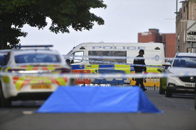 A police officer and vehicles are seen at a cordon in Irving Street in Birmingham after a number of people were stabbed in the city centre, Sunday, Sept. 6, 2020. British police say that multiple people have been injured in a series of stabbings in a busy nightlife area of the central England city of Birmingham.(Jacob King/PA via AP)