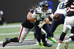 Seattle Seahawks quarterback Russell Wilson (3) is sacked by Atlanta Falcons defensive tackle Tyeler Davison (96) during the second half of an NFL football game, Sunday, Oct. 27, 2019, in Atlanta. (AP Photo/John Bazemore)