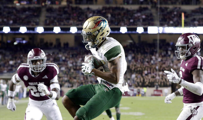 UAB wide receiver Andre Wilson, center, catches a pass in the end zone for a touchdown, between Texas A&M linebacker Tyrel Dodson (25) and defensive back Donovan Wilson, right, during the second half of an NCAA college football game Saturday, Nov. 17, 2018, in College Station, Texas. (AP Photo/Michael Wyke)