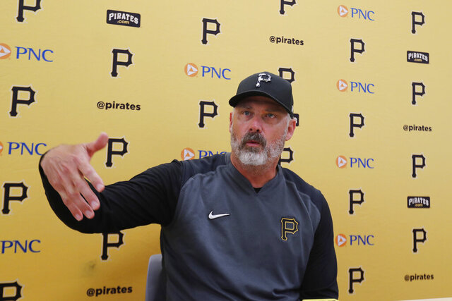 FILE - In this March 12, 2020, file photo, Pittsburgh Pirates manager Derek Shelton addresses the media after a spring training baseball game against the Toronto Blue Jays, in Bradenton, Fla. Shelton can't wait to get around his players, and not just because the first-year Pirates manager can show off his new pair of Jordans. Shelton is in a tight spot as he tries to get up to speed quickly with an organization he's been a part of for less than seven months.(AP Photo/Carlos Osorio, File)