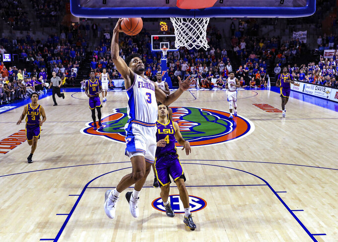 Florida guard Jalen Hudson (3) dunks the ball with seconds left in the second half of an NCAA college basketball game against LSU in Gainesville, Fla., Wednesday, March 6, 2019. (AP Photo/Gary McCullough)