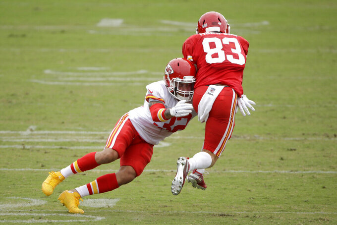 Kansas City Chiefs free safety Tyrann Mathieu (32) tackles wide receiver Cody Thompson (83) during NFL football training camp Friday, Aug. 2, 2019, in St. Joseph, Mo. (AP Photo/Charlie Riedel)