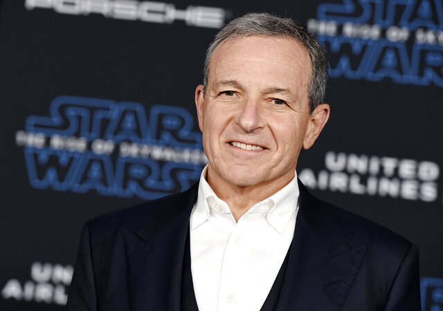 FILE - In this Dec. 16, 2019, file photo, Disney CEO Robert Iger arrives at the world premiere of