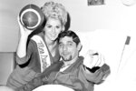 FILE - In this Dec. 27, 1966, file photo, New York jets quarterback Joe Namath gets a visit from Miss Sunken Garden, Karol Kelly, from St. Petersburg, Fla., prior to the operation on his right knee at Lenox Hill Hospital in New York. Namath is the NFL's greatest character. Guaranteed. The Pro Football Hall of Fame quarterback who guaranteed his three-touchdown underdog New York Jets would beat the mighty Baltimore Colts in the third Super Bowl was a solid choice in balloting conducted by The Associated Press in conjunction with the league's celebration of its 100th season. (AP Photo/File)