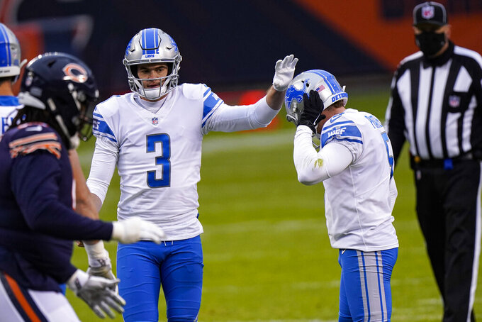 Detroit Lions kicker Matt Prater (5) reacts after missing an extra point against the Chicago Bears in the first half of an NFL football game in Chicago, Sunday, Dec. 6, 2020. (AP Photo/Nam Y. Huh)