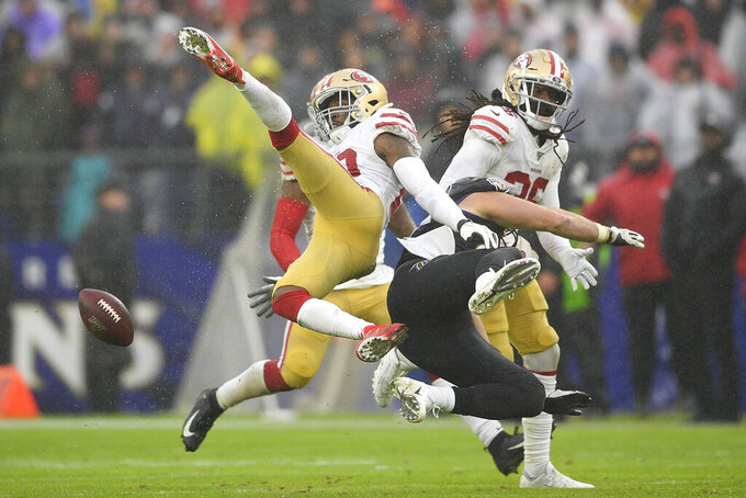 San Francisco 49ers free safety Jimmie Ward (20) looses control of the ball against Baltimore Ravens tight end Mark Andrews (89) in the second half of an NFL football game, Sunday, Dec. 1, 2019, in Baltimore, Md. (AP Photo/Nick Wass)
