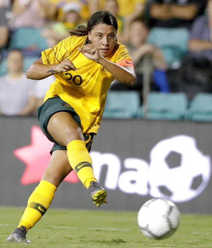 FILE - In this Feb. 28, 2019, file photo, Australia's Samantha Kerr plays against New Zealand during a Cup of Nations soccer match in Sydney, Australia. Kerr sat down on a metal bench after taking a few extra shots after a Chicago Red Stars practice. Red Stars coach Rory Dames poked fun at her competitive streak, and Kerr just laughed it off. If the Aussie star is on her way out of town, it was hard to tell on a picturesque summer afternoon in suburban Chicago.  (AP Photo/Rick Rycroft, File)