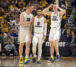 Marquette forward Sam Hauser, left, Markus Howard, center, and Joey Hauser, right, react after a missed shot against St. John's during the second half of an NCAA college basketball game Tuesday, Feb. 5, 2019, in Milwaukee. (AP Photo/Darren Hauck)