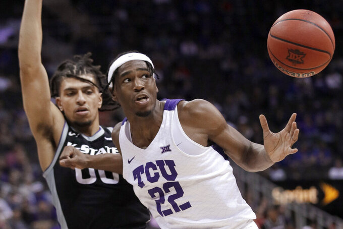 TCU guard RJ Nembhard (22) loses control of the ball while covered by Kansas State guard Mike McGuirl (00) during the second half of an NCAA college basketball game in the first round of the Big 12 men's tournament in Kansas City, Mo., Wednesday, March 11, 2020. Kansas State won 53-49. (AP Photo/Orlin Wagner)