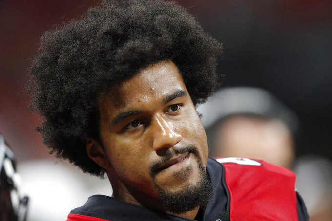 FILE - In this Aug. 15, 2019, file photo, Atlanta Falcons linebacker Vic Beasley (44) sits on the bench during the first half an NFL preseason football game against the New York Jets in Atlanta. Tennessee Titans general manager Jon Robinson says he has been in touch with Beasley and that the linebacker knows his absence from training camp is unexcused.  The Titans signed him to a one-year deal for $9.5 million in March to help bulk up their pass rush. (AP Photo/John Bazemore, File)