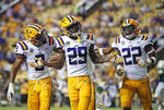 FILE - In this Sept. 8, 2018, file photo, LSU cornerback Greedy Williams (29) celebrates his interception with safety Grant Delpit (9) and cornerback Kristian Fulton (22) in the second half of an NCAA college football game against Southeastern Louisiana in Baton Rouge, La. LSU leads the nation with 14 interceptions.  (AP Photo/Gerald Herbert, File)