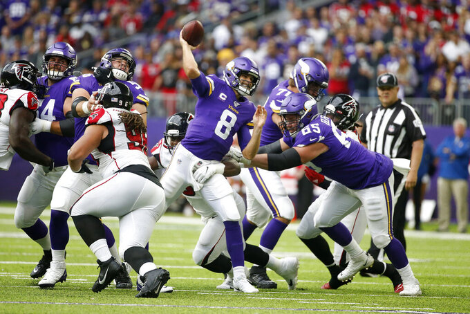 Minnesota Vikings quarterback Kirk Cousins throws a pass during the first half of an NFL football game against the Atlanta Falcons, Sunday, Sept. 8, 2019, in Minneapolis. (AP Photo/Bruce Kluckhohn)