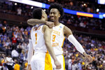 Tennessee's Jordan Bowden, right, and Lamonte Turner (1) celebrate after winning a second round men's college basketball game in the NCAA Tournament against Iowa, Sunday, March 24, 2019, in Columbus, Ohio. (AP Photo/John Minchillo)
