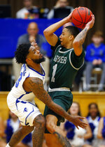 Seton Hall guard Myles Powell (13) defends against Wagner guard Atiba Taylor (1) during the first half of an NCAA college basketball game, Tuesday, Nov. 5, 2019, in South Orange, N.J. (AP Photo/Noah K. Murray)