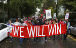 Dozens of Chicago Teachers Union members and supporters march through the streets of Chicago's Hyde Park neighborhood during the
