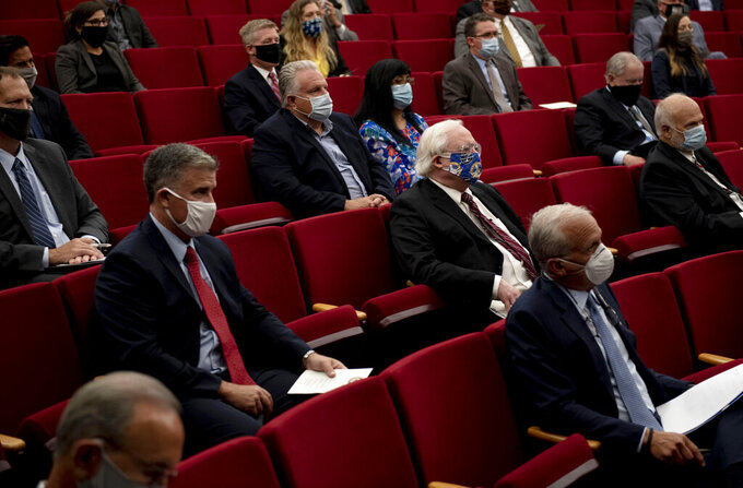 DELETES REFERENCE TO LAW ENFORCEMENT OFFICIALS - Attendees sit apart while listening to U.S. Attorney General William Barr speak at the Gerald R. Ford Presidential Museum in Grand Rapids, Mich., Thursday, July 16, 2020. (Nicole Hester/Mlive.com/Ann Arbor News via AP)