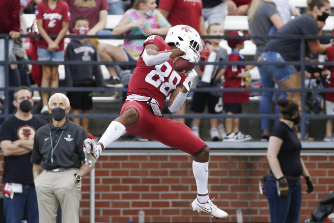 Washington State wide receiver De'Zhaun Stribling catches a pass during the second half of an NCAA college football game against Portland State, Saturday, Sept. 11, 2021, in Pullman, Wash. (AP Photo/Young Kwak)