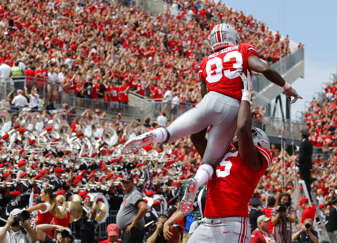 Ohio State receiver Terry McLaurin is lifted in celebration by teammate Jaylen Harris after scoring a touchdown against Oregon State during the first half of an NCAA college football game Saturday, Sept. 1, 2018, in Columbus, Ohio. (AP Photo/Jay LaPrete)