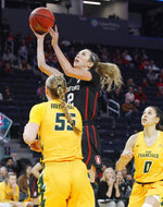 Stanford's Lexie Hull shoots between San Francisco's Abby Rathbun (55) and Mikayla Williams (0) during the first half of an NCAA college basketball game, Saturday, Nov. 9, 2019, in San Francisco. (AP Photo/George Nikitin)