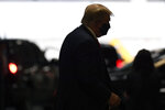 President Donald Trump steps out of his vehicle with a face mask on in New York, Friday, Aug. 14, 2020, on his way to visit with his younger brother, Robert Trump, who has been hospitalized in New York. (AP Photo/Susan Walsh)