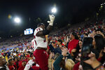 Fresno State offensive lineman Alex Akingbulu (75) celebrates with fans after a win over UCLA in an NCAA college football game Sunday, Sept. 19, 2021, in Pasadena, Calif. (AP Photo/Marcio Jose Sanchez)