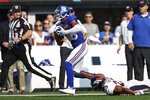 New York Giants wide receiver Darius Slayton (86) is tackled by Denver Broncos cornerback Kyle Fuller (23) during the first half of an NFL football game Sunday, Sept. 12, 2021, in East Rutherford, N.J. (AP Photo/Adam Hunger)