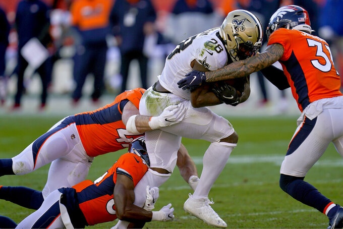 New Orleans Saints running back Latavius Murray (28) is hit by Denver Broncos free safety Justin Simmons, right, during the first half of an NFL football game, Sunday, Nov. 29, 2020, in Denver. (AP Photo/David Zalubowski)