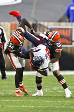 Cleveland Browns defensive back Ronnie Harrison (33) and linebacker Mack Wilson (51) tackle Houston Texans wide receiver Randall Cobb (18) during the second half of an NFL football game, Sunday, Nov. 15, 2020, in Cleveland. (AP Photo/Ron Schwane)