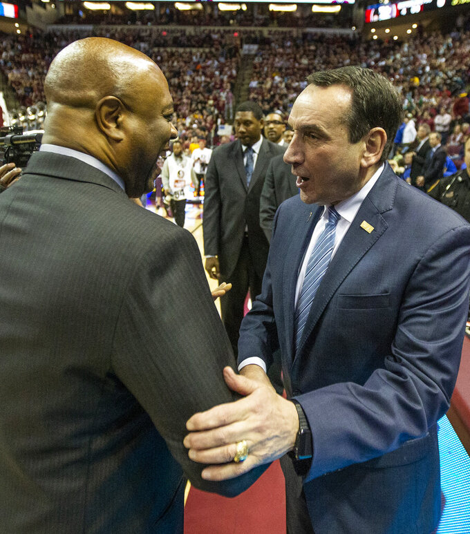 Duke head coach Mike Krzyzewski, right, and Florida State head coach Leonard Hamilton greet before an NCAA college basketball game in Tallahassee, Fla., Saturday, Jan. 12, 2019. (AP Photo/Mark Wallheiser)