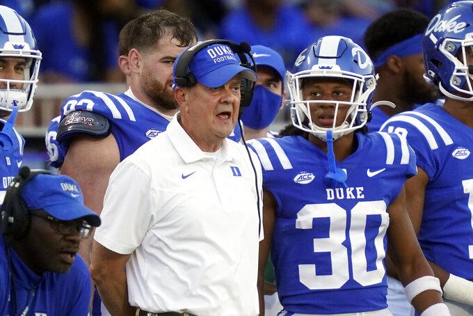 Duke head coach David Cutcliffe looks on with Duke safety Brandon Johnson (30) during the second half of an NCAA college football game against Kansas in Durham, N.C., Saturday, Sept. 25, 2021. (AP Photo/Gerry Broome)