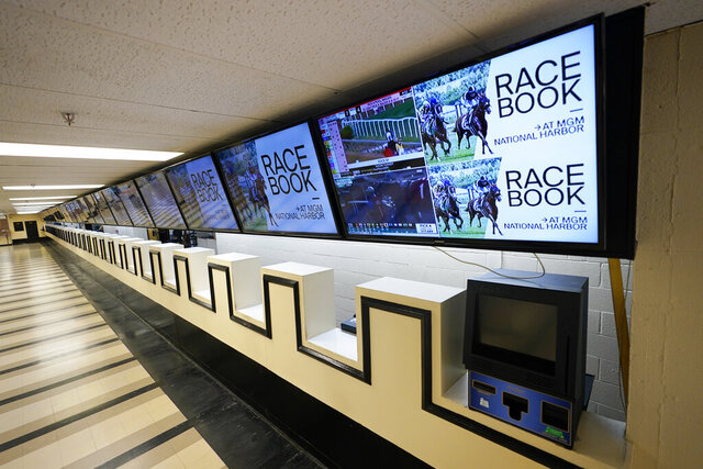 Betting windows are empty at Pimlico race track, Friday, Oct. 2, 2020, in Baltimore, Md., ahead Saturday's Black-Eyed Susan and Preakness Stakes races. (AP Photo/Steve Helber)