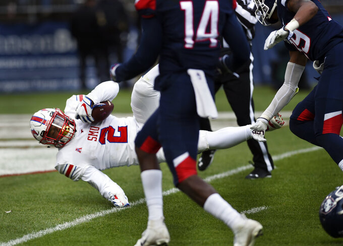 SMU running back Ke'Mon Freeman (2) crosses the goal line for a  touchdown in the first half of an NCAA college football game against Connecticut, Saturday, Nov. 10, 2018, in East Hartford, Conn.(AP Photo/Stephen Dunn)