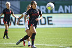 In this photo provided by the Portland Thorns, Portland Thorns' Sophia Smith chases the ball during an NWSL soccer match against Utah on Sunday, Sept. 20, 2020, in Portland, Ore. The No. 1 pick in the National Women's Soccer League draft and U.S. national team prospect, Smith comes from a family of basketball players — and it was just assumed she'd head in the same direction. Turned out Smith was right to choose soccer. It paved her way to Stanford, and now to a career in the NWSL.   (Craig Mitchelldyer/Portland Thorns via AP)